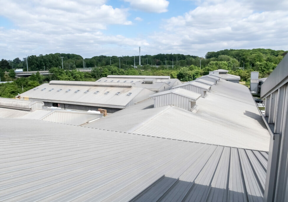 on a long building there is an aluminum roof with different roof domes